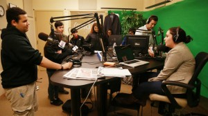 Brian Foster, a junior at Excel High School, speaks on air in the Herald Radio studio with Joe Battenfeld and Erica Moura during a visit the Boston Herald.